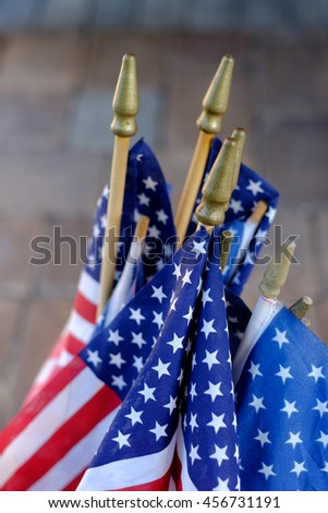 red white and blue flags out as a decoration on a porch during the american fourth of July holiday - stock photo