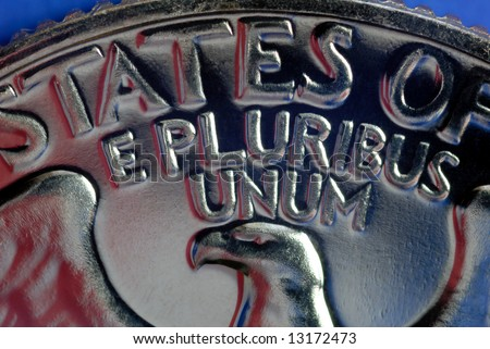 Red, White, and Blue From American Flag Reflected in E Pluribus Unum Motto on Vintage, Retro, 1967 United States Quarter - stock photo