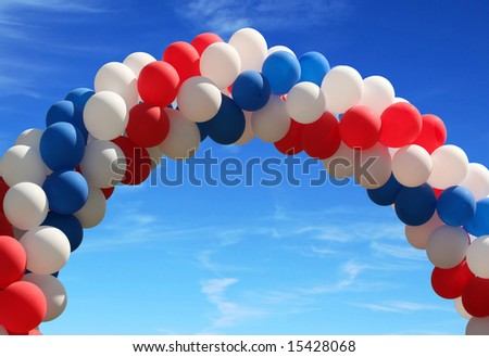 Red white and blue patriotic balloons on pretty blue sky - stock photo