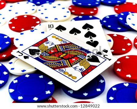 Red White and Blue Poker Chips and Black Jack on White Background