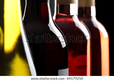 Red white and ros? wine bottles in a row - stock photo