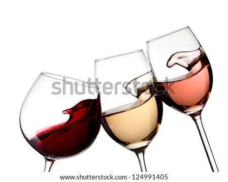 Red, white and rose wine glasses up - stock photo