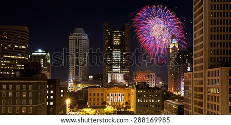 Red, White & Boom light the Columbus, Ohio skyline. - stock photo