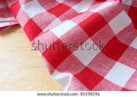 red white towel on wooden table