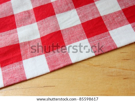 red white towel on wooden table - stock photo