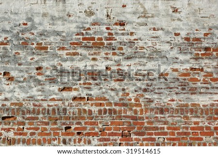 Red White Vintage Brick Painted Wall With Damaged Plaster Background Texture - stock photo