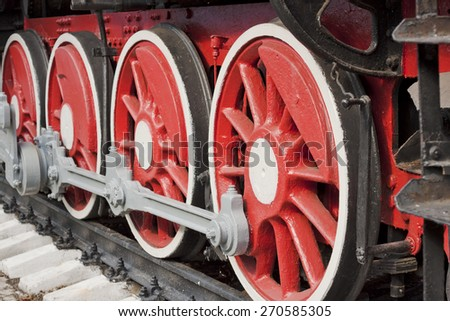 Red-white wheels of the old steam locomotive