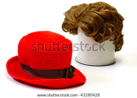 red wig and red  bonnet on white isolated - stock photo