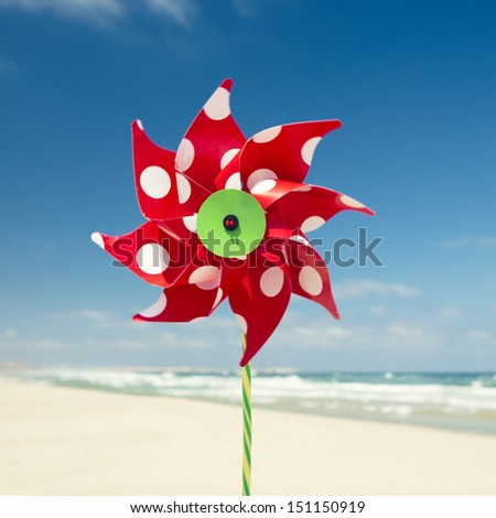 Red windmill with a beach as a background - stock photo