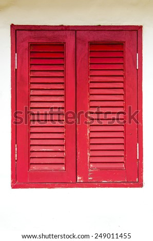 Red window on white wall - stock photo