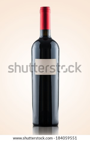 red wine and a bottle isolated over a warm gradient background - white label - stock photo