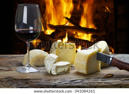red wine and cheese board in the restaurant - stock photo