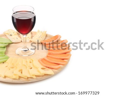 Red wine and cheese composition. Whole background. Place for text.