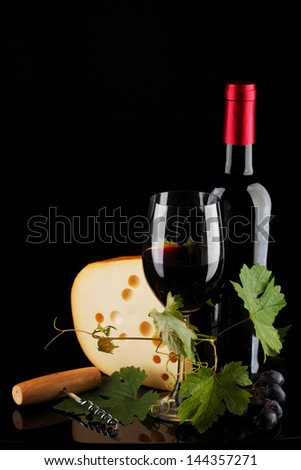 red wine and cheese on black - stock photo