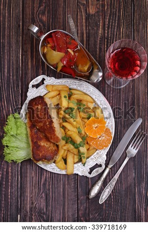 Red wine and chicken fillet submitted with a potato and vegetables - stock photo
