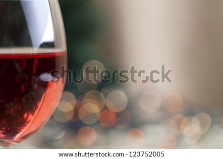 Red wine and Christmas light reflection with soft focus - stock photo