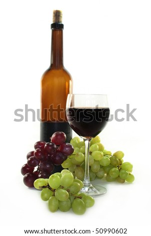 Red wine and dark and bright grapes on a white background