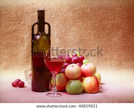 Red wine and fruit against a brown sacking - still life - stock photo