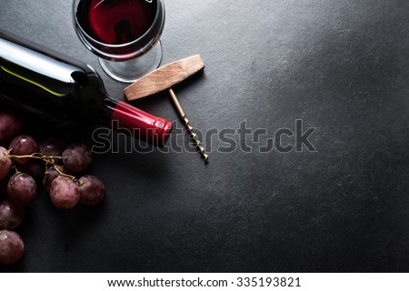 Red wine and grapes border background - stock photo