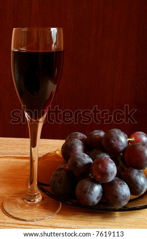 Red wine and grapes. Cuisine and food image.
