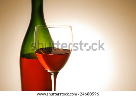 Red wine and green bottle on white background