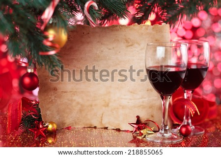 Red wine and old parchment against Christmas background. - stock photo