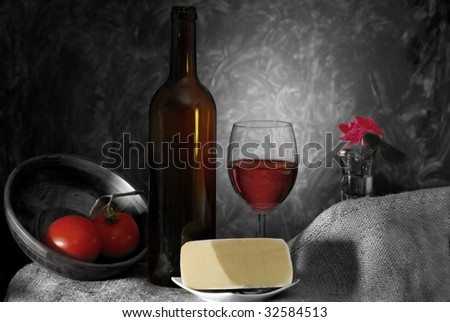 Red wine and snacks in low light, with abstract background
