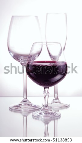 red wine and wineglasses on a mirror table
