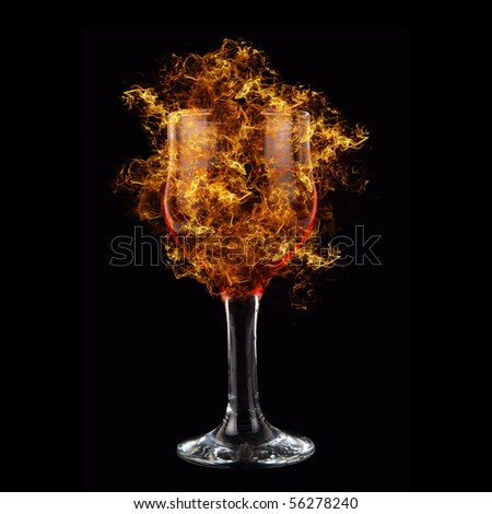 red wine at fire on black background - stock photo