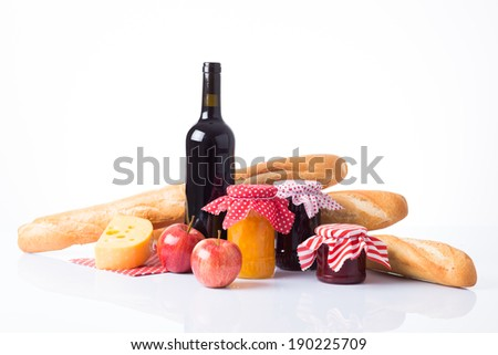 Red wine, baguette, cheese and grapes