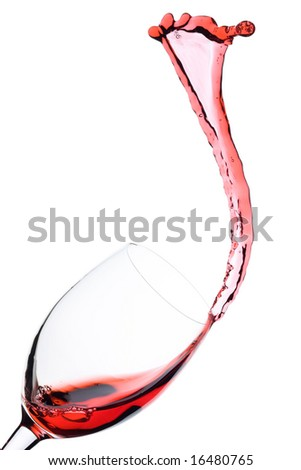 Red Wine being poured in a wine glass; isolated on a white background. - stock photo