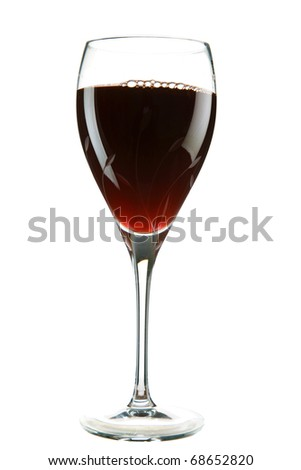 red wine being poured into a cut crystal wine glass    isolated on white with room for your text - stock photo