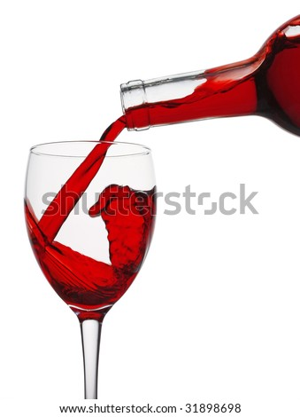 Red wine being poured into a glass from a bottle