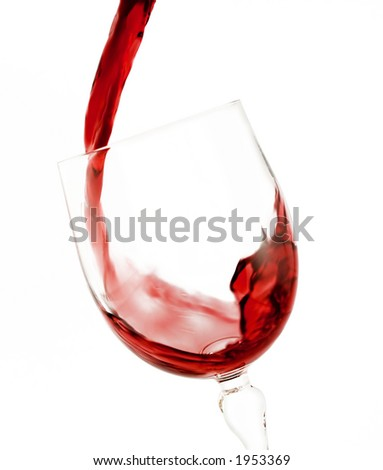 Red wine being poured into a wine glass isolated on a white background - stock photo