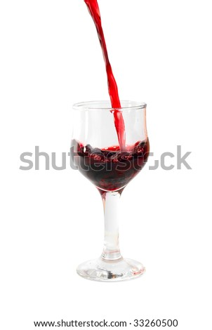 Red wine being poured into a wine glass isolated on white - stock photo