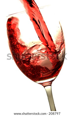 Red wine being poured into a wine glass. Isolated on white background