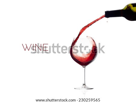 Red wine being poured into balloon glass. Splash. isolated on white with sample text