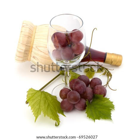 red wine bottle and glass full with grapes  isolated on white background