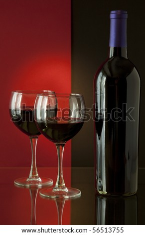 Red Wine Bottle and Glasses on Colorful Background - stock photo