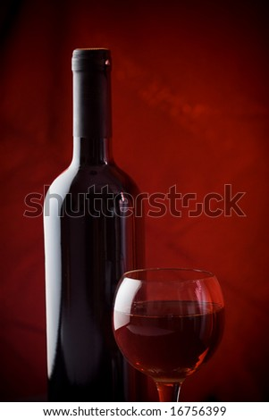 Red wine bottle and red wine glass - stock photo