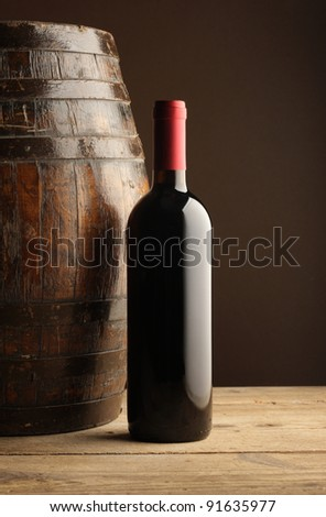 red wine bottle and wodden barrel - stock photo