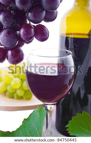 Red wine bottle, glass and cask with grapes over white - stock photo