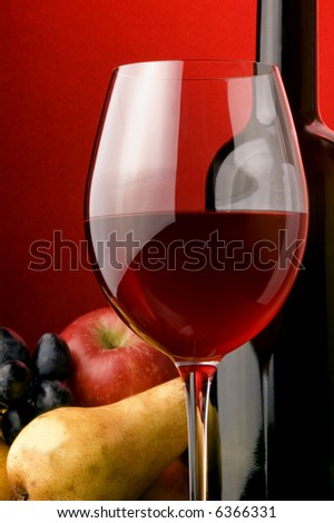 red wine bottle grape pear apple  glass - stock photo