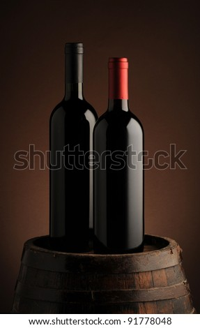 red wine bottle on wodden barrel