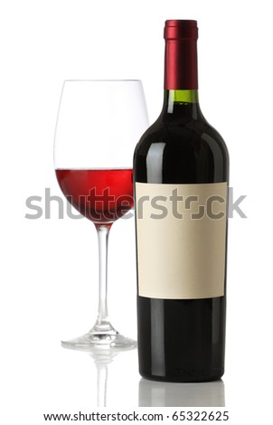 Red wine bottle with and empty label and glass - stock photo