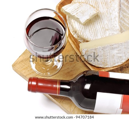 Red wine, Brie and Camembert on the wood surface, isolated, white background - stock photo