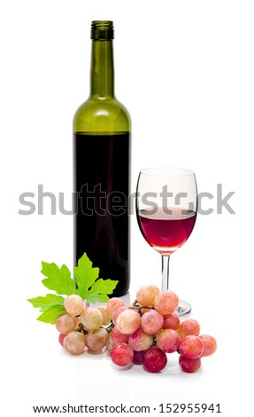 red wine bring poured from bottle and fresh red grapes. on white background