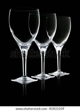 Red wine devided in three elegant wine glasses