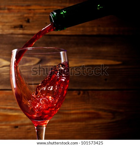 red wine flows in a glass - stock photo