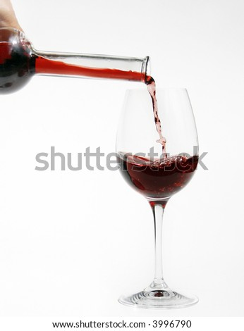 red wine from bottle into a glass - stock photo
